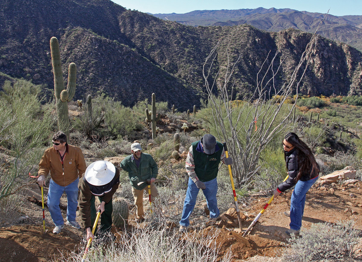 Volunteers finish up the final piece of trail